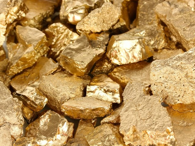 The flow sheet of gold ore processing includes crushing and screening, grinding, gravity concentration